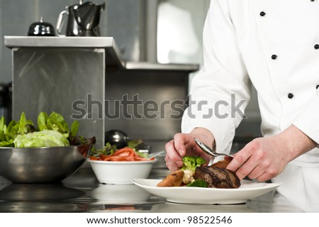 Chef preparing meal (steak with croquette)