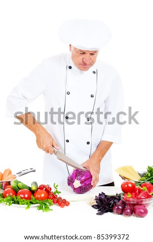 chef preparing salad with cabbage against white background