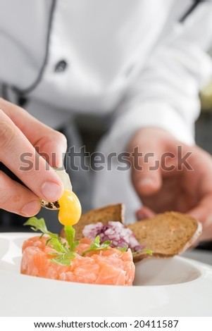 Chef preparing salmon salad