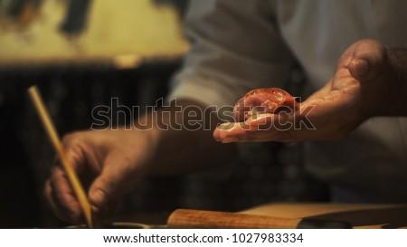 Chef preparing sushi.