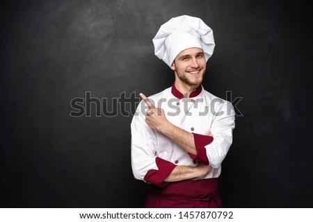 Chef presents something on a black background