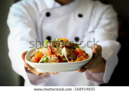 Shutterstock Chef proudly presenting Thai spicy crab papaya salad - Lao, Isan cuisine