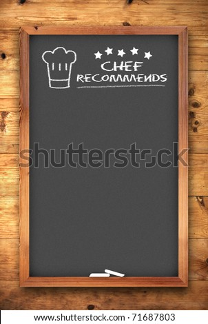 chef recommends chalkboard on wooden background