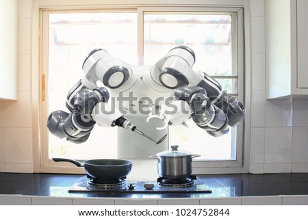 Chef robot Cooking In the kitchen of the future home genius. Intelligent robots work in modern homes, future lifestyle ideas.