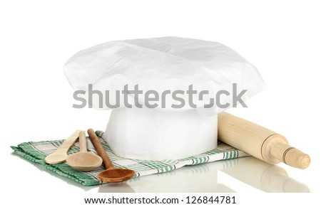 Chef's hat with spoons and battledore isolated on white