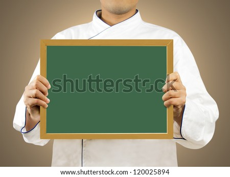 Chef showing blank chalkboard