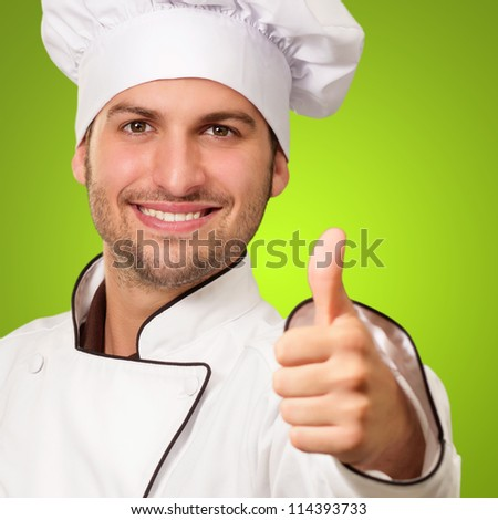 Chef Showing Thumb Up Sign On Green Background