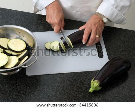 Chef slicing eggplant