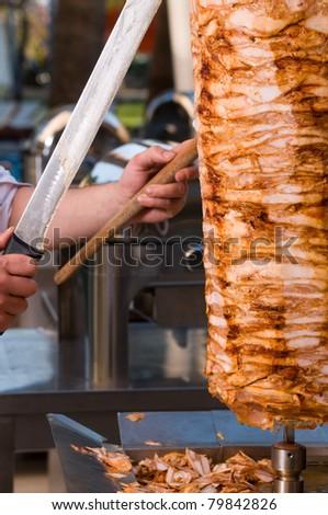 Chef slicing Turkish doner kebab