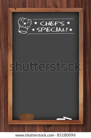 chef special chalkboard on wooden background