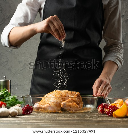chef sprinkles frozen salt, chicken with fruit close up, background for recipe book, menu, instagram