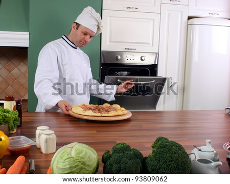 Chef the pizza maker working in kitchen