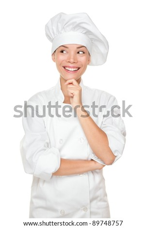 Chef thinking looking smiling and happy to the side. Woman chef, cook or baker in chef uniform and hat. Young asian female isolated on white background.