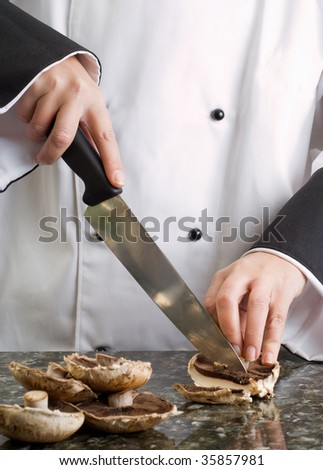 Chef Wearing Black and White Uniform Slicing Brown Mushrooms