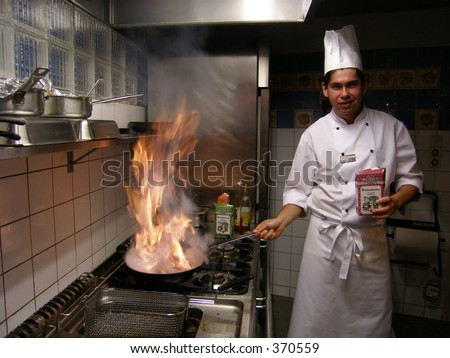Chef with burning flames - stock photo