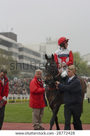 CHELTENHAM, GLOUCS, APRIL 17 2009: Jockey Jack Doyle rides Kings Forest out of the parade ring at the April National Hunt Meeting at Cheltenham Racecourse for the second race, Cheltenham UK - stock photo