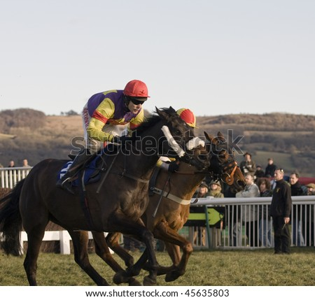 CHELTENHAM, GLOUCS - JAN 30: Jockey Tom Scudamore (L) and Joe Tizzard (R) race to the line in the fourth race at Cheltenham Racecourse January 30, 2010 in Cheltenham, Gloucestershire