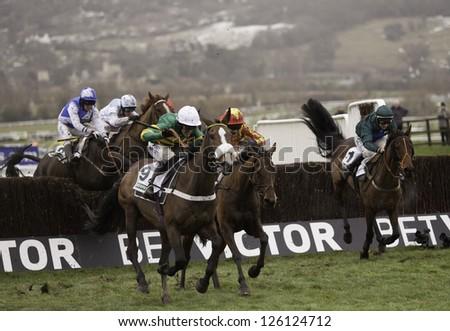 CHELTENHAM, GLOUCS-JANUARY 26: Jockeys take their horses over jumps in the third race at Festival Trials Day, Cheltenham Racecourse, Cheltenham UK on Jan 26, 2013.