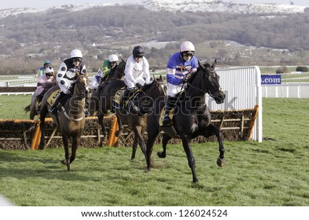 CHELTENHAM, GLOUCS-JANUARY 26: Ruby Walsh takes Irish Saint over hurdles in the first race at Festival Trials Day, Cheltenham Racecourse, Cheltenham UK on Jan 26, 2013.