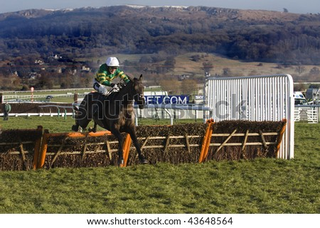 CHELTENHAM, GLOUCS: jockey A P McCoy rides Four Strong Winds to second place over hurdles in the first race at Cheltenham Racecourse, UK, January 1 2010, Cheltenham, Gloucestershire