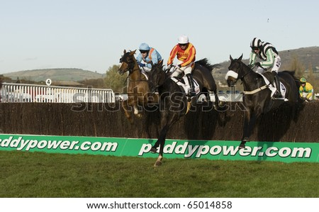 CHELTENHAM, GLOUCS; NOV 13: Jockeys battle over fences in the third race at Cheltenham Racecourse, UK, November 13, 2010 in Cheltenham, Gloucestershire