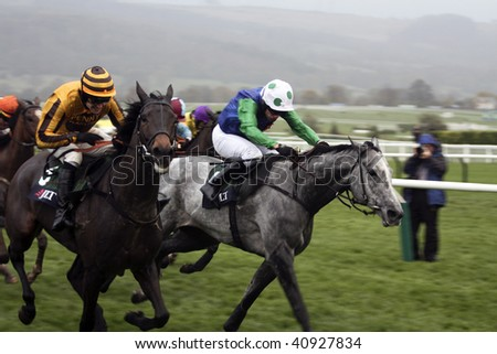 CHELTENHAM, GLOUCS; NOV 14: Jockeys Ruby Walsh and Timmy Murphy ride against each other in the fifth race at Cheltenham Racecourse, Uk, 14 November 2009 in Cheltenham, Gloucs