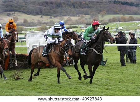 CHELTENHAM, GLOUCS; NOV 14:  jockeys Tony McCoy and Paddy Brennan battle for supremacy in the first race at Cheltenham Racecourse, UK, 14th November 2009 in Cheltenham, Gloucs