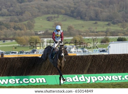 CHELTENHAM, GLOUCS; NOV 13: Paddy Brennan takes Billie Magern over fences in the second race at Cheltenham Racecourse, UK, November 13, 2010 in Cheltenham, Gloucestershire