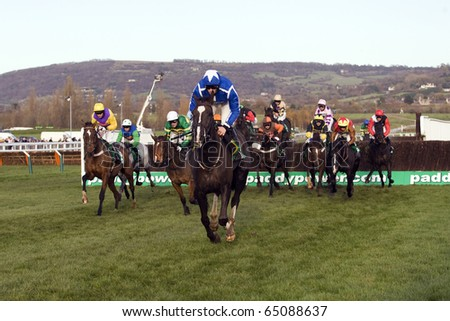 CHELTENHAM - NOV 13: Sam Twiston-Davies leads the field over fences in the fourth race at Cheltenham Racecourse, UK, November 13, 2010 in Cheltenham, Gloucestershire
