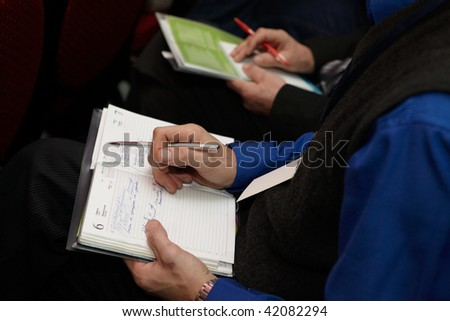 CHELYABINSK - NOVEMBER 26: Listener making notes at Agricultural Conference Divident Extreme - New Offer of Syngenta Company, November 26, 2009 in Hotel Park City, Chelyabinsk, Russia.