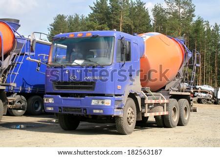 CHELYABINSK REGION, RUSSIA - AUGUST 23, 2008: New CAMC concrete mixer truck at the interurban road.