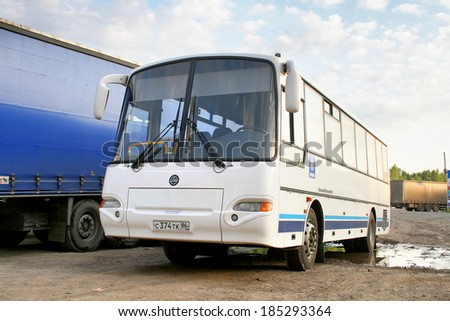 CHELYABINSK REGION, RUSSIA - JUNE 12, 2009: White KAVZ 4238 Avrora interurban coach at the interurban road. #185293364