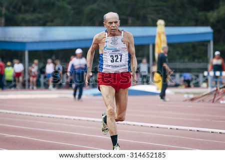 Chelyabinsk, Russia - August 28, 2015:  75 year old man runs during championship of Russia on track and field athletics among the elderly, Chelyabinsk, Russia - August 28, 2015