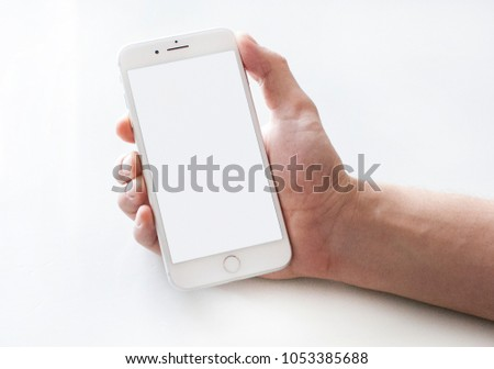 Chelyabinsk, Russia, February 3, 2018: High detailed Realistic smartphone in man hand. White Iphone 8 plus mock up. #1053385688