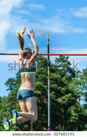 Chelyabinsk, Russia - July 24, 2015:  Girl athlete competing in the pole vault  during National competitions in memory of G. I. Nicewhen athletics, Chelyabinsk, Russia - July 24, 2015