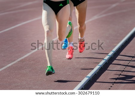 Chelyabinsk, Russia - July 24, 2015: girl athletes running distance during National competitions in memory of G. I. Nicewhen athletics, Chelyabinsk, Russia - July 24, 2015