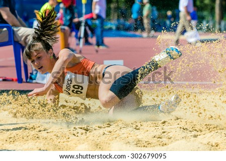 Chelyabinsk, Russia - July 24, 2015: long jump girls during National competitions in memory of G. I. Nicewhen athletics, Chelyabinsk, Russia - July 24, 2015