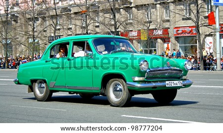 "CHELYABINSK, RUSSIA - MAY 9: Soviet motor car GAZ-21 ""Volga"" exhibited at the annual Victory Parade on May 9, 2011 in Chelyabinsk, Russia."
