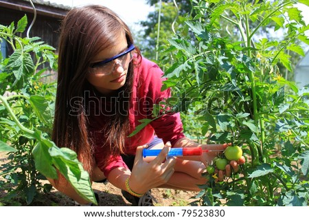 chemical agriculture, a young beautiful girl
