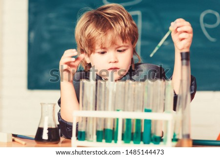 Chemical analysis. Science concept. Wunderkind experimenting with chemistry. Boy use microscope test tubes chemistry school classroom. Kid study chemistry. Biotechnology and pharmacy. Genius pupil.