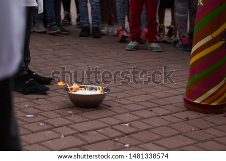 chemical experiments for children a plate with fuel lies on the paving stones