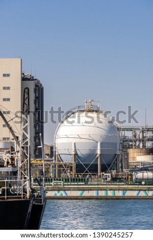 Chemical Factory plant with gas storage and structure of pipeline with smoke from smokestack in Kawasaki City near Tokyo Japan #1390245257