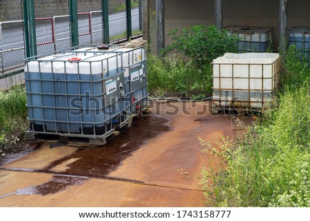 Chemical factory plastic container leaking pollution leak rusty spill