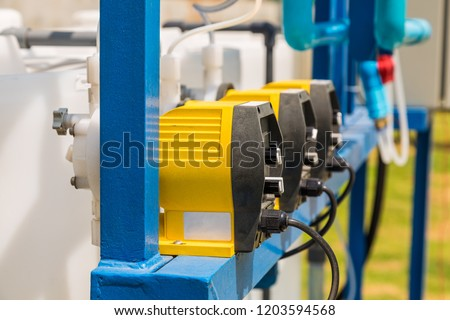 Chemical feed pumps for water treatment system