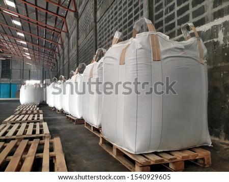 Chemical fertilizer Urea Stock pile jumbo-bag in warehouse waiting for shipment. Photo stock ©