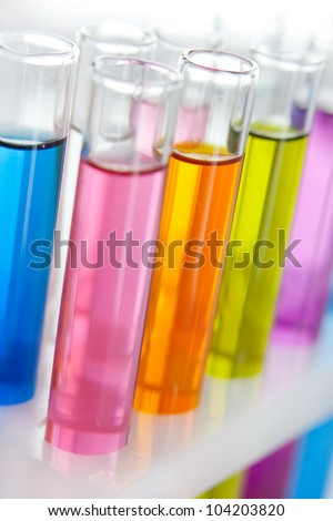 Chemical flask with a blue laboratory test tubes inside, isolated