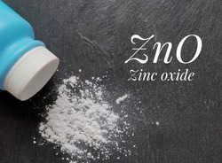 Chemical formula of zinc oxide molecule with white zinc oxide powder and a blue plastic bottle. Zinc oxide is used to treat or prevent diaper rash, minor burns, chapped skin, or skin irritation.