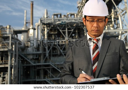 chemical industrial engineer write on board serious