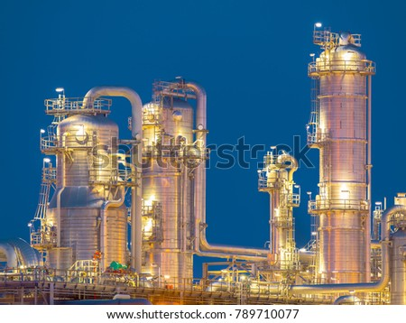 Chemical industry distillation towers detail at night. Petrochemical background Europoort.