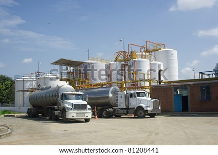 Chemical Industry, Storage Tank And Tanker Truck In Industrial Plant - stock photo